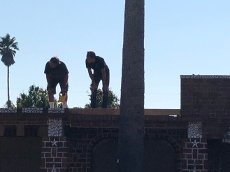 Taylor and Steve assessing best approach to installing roof and flashing