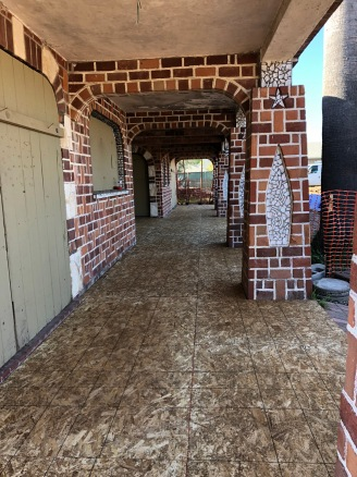 Nice protective wood cover over the historic tile veranda