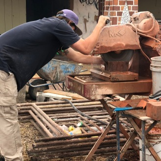 Resizing bricks to cap the well house homage column
