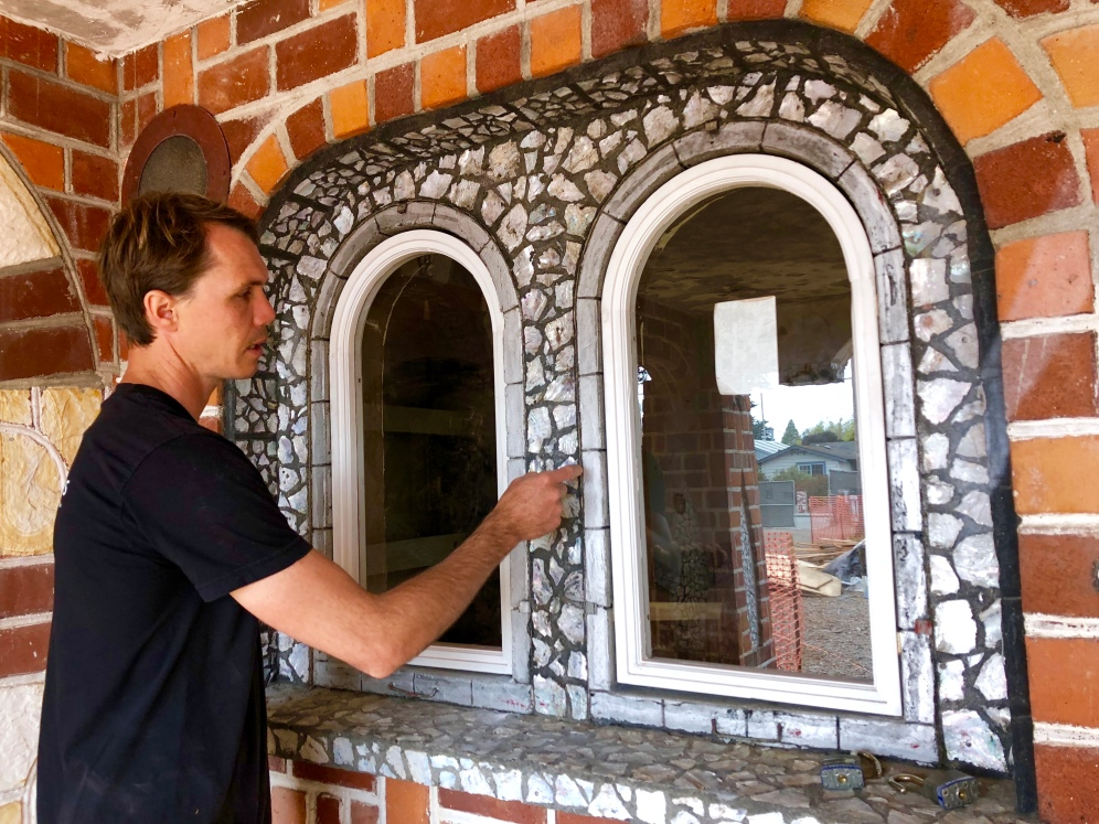 Taylor reviewing new windows for the Yogi Temple