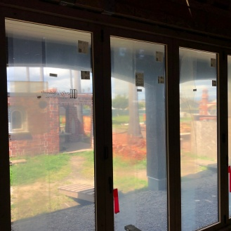 inside looking out of these doors out to where our back patio will be