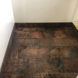 powder room floor tiles installed (grout comes later)