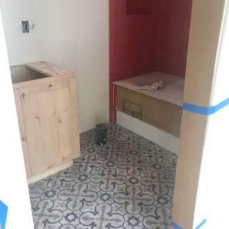 one of the upstairs bathrooms with tile installed