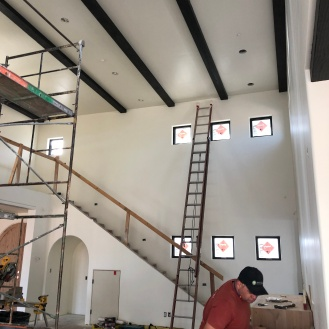 Brian, our foreman, installing the media center in the living room