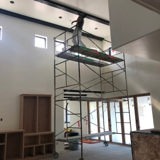 Our painters hard at work touching up after beam installs