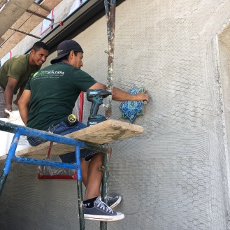 Lino and Lecho installing our deco tiles along the exterior walls...