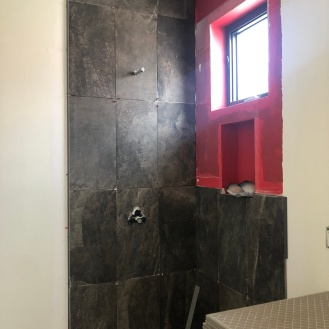 and tile wall of upstairs shower