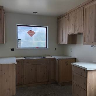 ADU kitchen cabinets installed and countertop almost finished